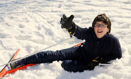Boy asks for help after the fall on skis Stock Photos