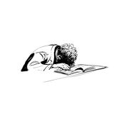 Boy asleep on a textbook education school Stock Photo