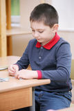 Boy assembling puzzles Royalty Free Stock Images