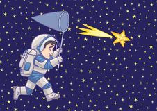 Boy astronaut catches a falling star. Stock Image