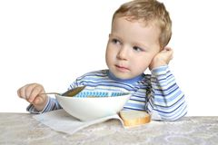 Boy At The Dinner Table Stock Images