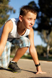 Boy At The Start Before Running Royalty Free Stock Image