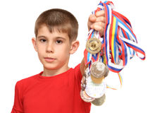 Boy-athlete with medals Stock Photography
