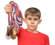 Boy-athlete with medals Royalty Free Stock Image
