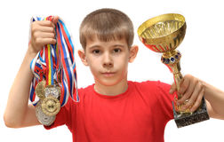 Boy-athlete with medals Stock Images