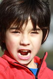 A Boy on the attack. Portait of a 10 years old asian boy yelling attack Stock Photo