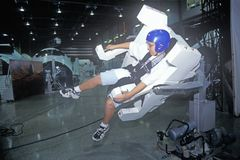 A boy attending space camp at the George C. Marshall Space Flight Center in Huntsville, Alabama, tries a MMU 1-G Trainer Royalty Free Stock Images