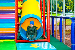 The boy on the attraction. Little boy riding on the hill children's attraction Stock Image