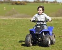 Boy on ATV. Young boy riding ATV fast Stock Photos