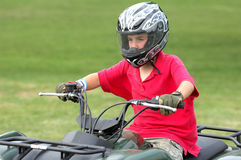 Boy on ATV. Young boy riding four-wheeler ATV Royalty Free Stock Images