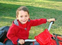 Boy on ATV. Young boy riding four-wheeler ATV Stock Image