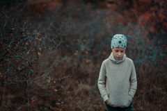 Boy in autumn bushes with berries Stock Photos