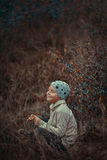 Boy in autumn bushes with berries Royalty Free Stock Images