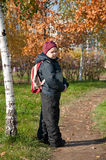 A boy  in the autumn City Park Stock Image