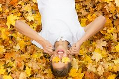 Boy in autumn leaves , royalty free stock images