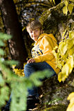 Boy in the autumn park Royalty Free Stock Images