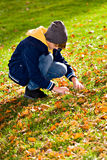 Boy in the autumn park Stock Photo