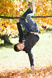Boy in the autumn park Stock Photos