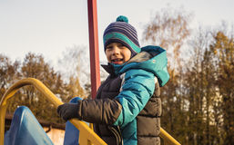 Boy in autumn Park Stock Images