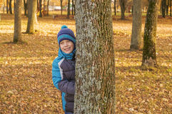 Boy in autumn Park. A child playing in the Park and having fun Royalty Free Stock Photos