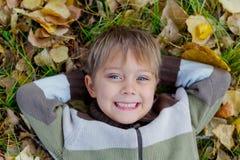 Boy in a autumn park Stock Photos