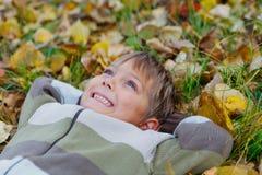 Boy in a autumn park Stock Photo