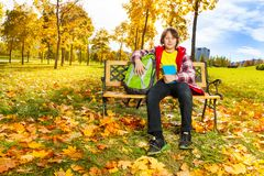 Boy in the autumn park after school stock photos