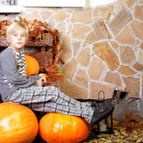 Boy with autumn pumpkin Stock Image