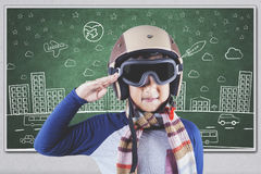 Boy with an aviator helmet in class Royalty Free Stock Image