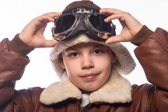 The boy is an aviator in the jacket of the pilot and in old glasses Royalty Free Stock Photos