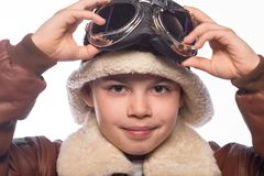 The boy is an aviator in the jacket of the pilot and in old glasses Royalty Free Stock Image