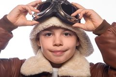 The boy is an aviator in the jacket of the pilot and in old glasses Stock Images