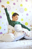 Boy Awakening in his bed Royalty Free Stock Images