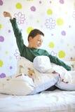 Boy Awakening in his bed Royalty Free Stock Images
