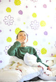 Boy Awakening in his bed. In morning time Stock Photography