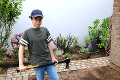 Boy with ax Stock Photo