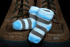 Boy baby booties on shoes Royalty Free Stock Images