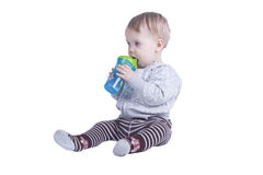 Boy and baby bottle Stock Photo