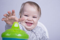 Boy and baby bottle Royalty Free Stock Photography