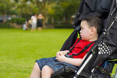 Boy in baby buggy Stock Photo