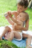 Boy and baby playing outdoors Royalty Free Stock Image