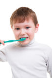 Boy without baby teeth with toothbrush Stock Images