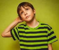 Boy baby thinks kid looking disheveled thoughts Stock Photo