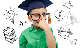 Boy in bachelor hat and eyeglasses over doodles Stock Photo