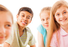 Boy on the back in focus with friends Royalty Free Stock Photography