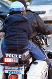 Boy on back of police motorcycle Royalty Free Stock Image
