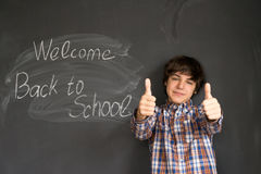 Boy and back to school black board Royalty Free Stock Photos