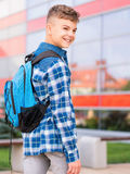 Boy back to school. Outdoor portrait of happy teen boy 12-14 years old with backpack. Young student beginning of class after vacation. Back to school concept Royalty Free Stock Photo