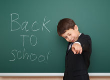Boy with back to school text on board Stock Photo