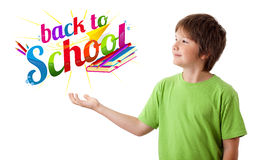 Boy with back to school theme isolated on white. Boy looking with back to school theme isolated on white Royalty Free Stock Image
